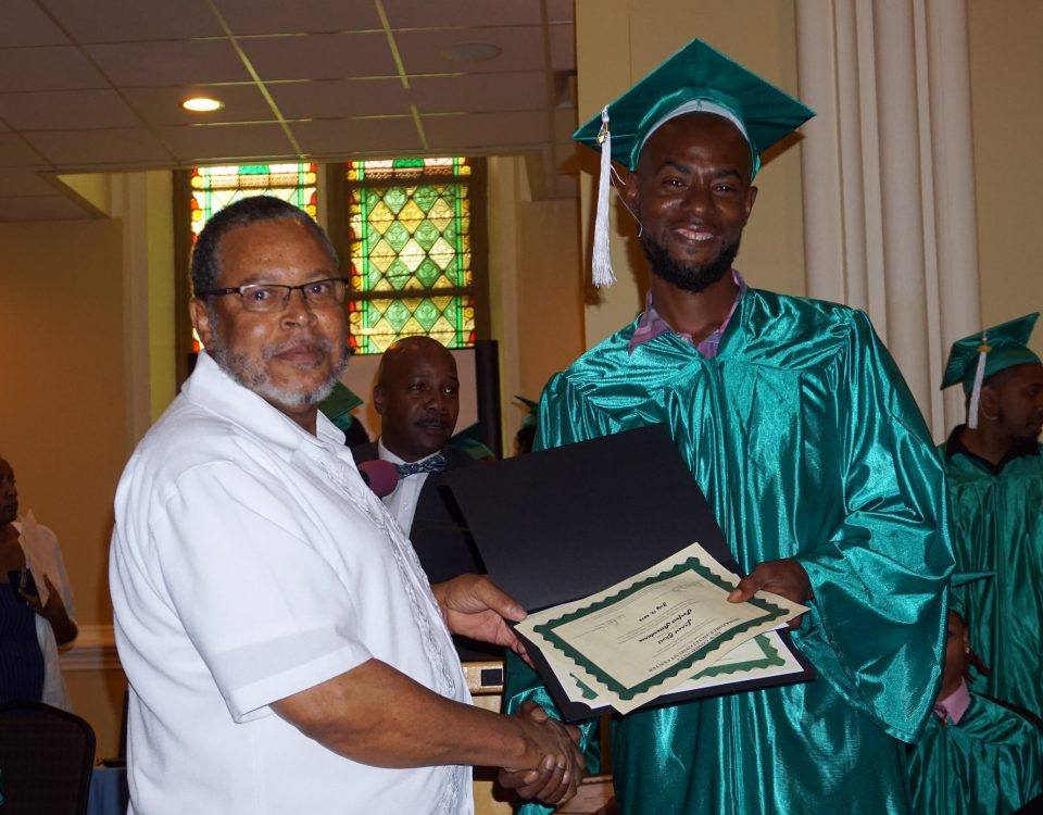 Ernest Short receiving his certificate from Building Trades Specialist instructor William Robinson