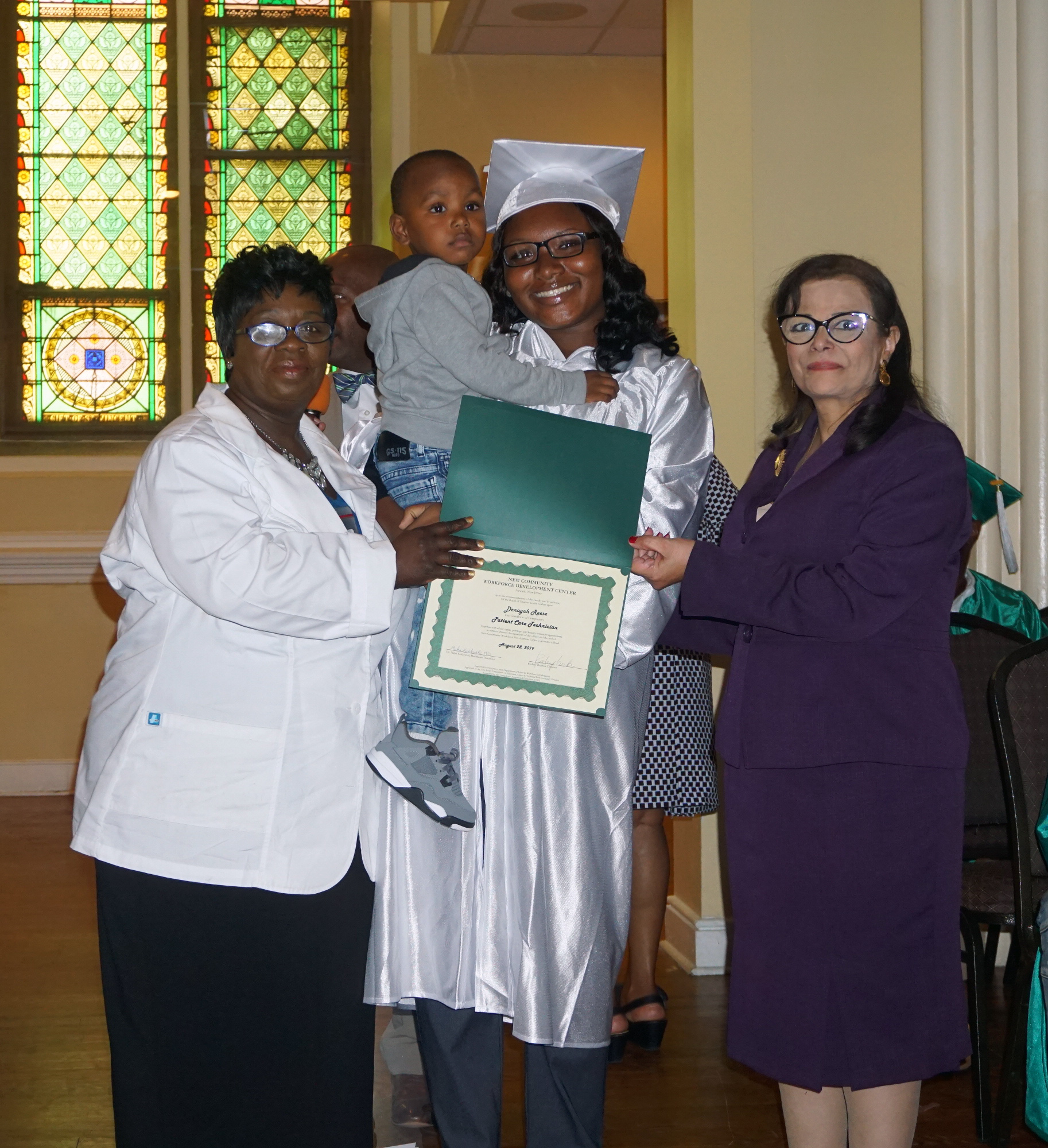 Denayah Reese receiving her certificate.